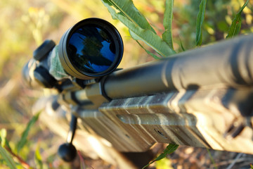 Bolt action sniper rifle with telescopic sight closeup