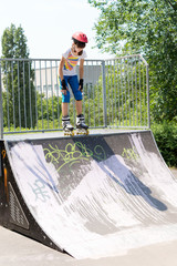Teenage girl on a roller skating ramp