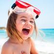canvas print picture - Bambina al mare con maschera che ride