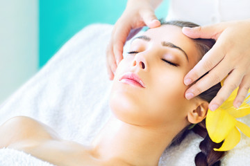 Woman receiving spa head massage