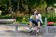 Young roller skater taking a rest