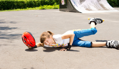 Young girl falling while roller skating