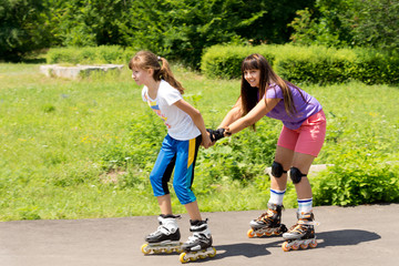 Two female friends roller skating
