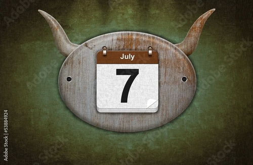 Old wooden calendar with July 7, San Fermin.