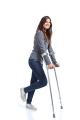 Woman walking with crutches