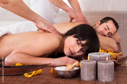 Beautiful Young Couple Enjoying Massage