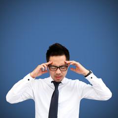 Thinking man isolated on blue background