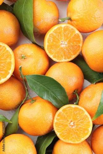 Top view of fresh tangerines with leaves.