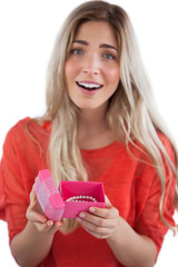 Surprised blonde woman opening gift