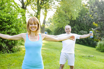 Personal trainer with client exercising outside