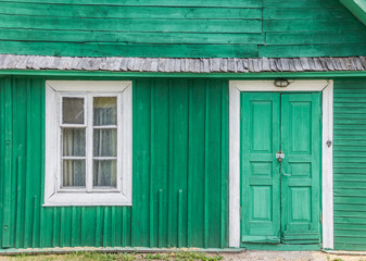 Detail of a traditional green wooden house in Trakai