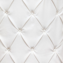White leather texture with buttons