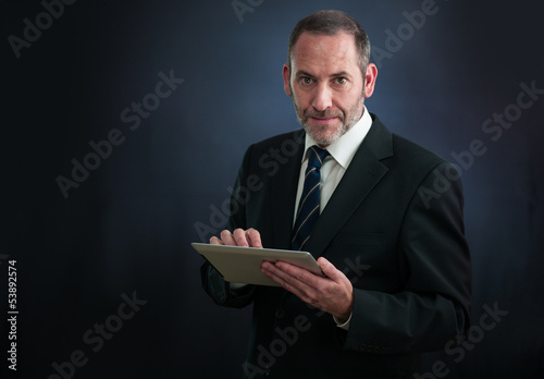 Happy ature businessman working with tablet