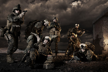 U.S. Marines under fire, rescues colleague