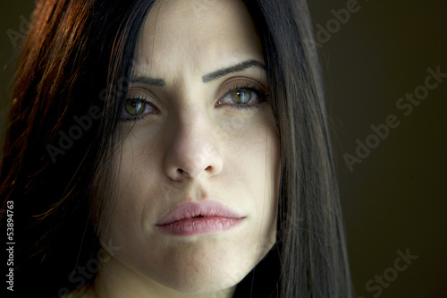 Closeup of sad beautiful woman