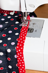sewing dress on machine