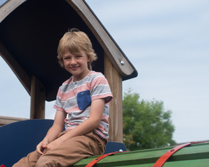 young boy on climbing frame