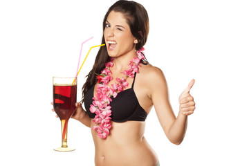 brunette holding a cocktail, wink and showing thumbs up
