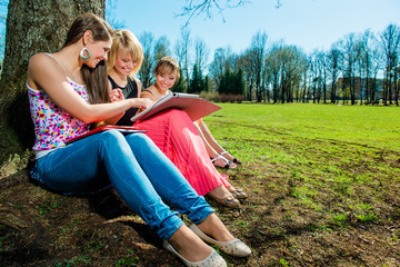 Group of students studying outdoors