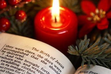 Open Bible and Christmas decorations.
