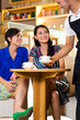 Young women in an Asian coffeeshop