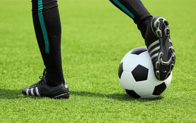 soccer ball with foot of player touching it