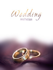 Gold wedding rings on a big brown leaf