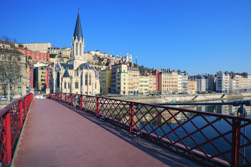 Famous view of Saone river and red footbridge in Lyon city