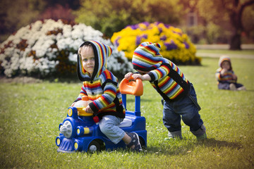 Little boys playing in the park.