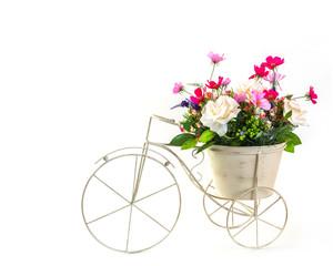 Bouquet of flowers in steel bucket on mini tricycle model