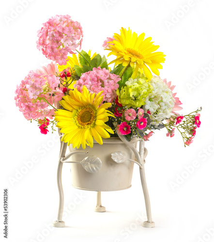Bouquet of flowers in steel bucket