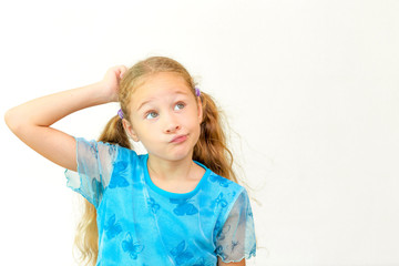Cheerful smiling little girl at the white background. School con