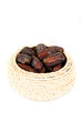 Dry dates in bowl on white background