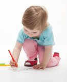 Child drawing a picture with colorful felt-tip pens
