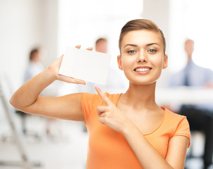woman pointing at white blank card in office