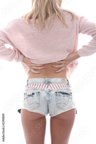 Sexy Young Woman Wearing Denim Shorts and a Jumper