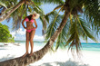 Beautiful woman stand on the palm