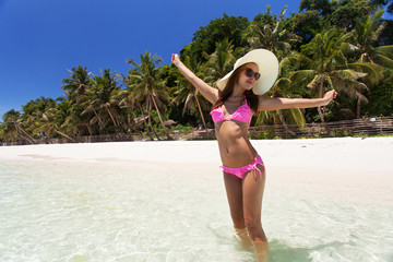 Beautiful woman on a paradise beach