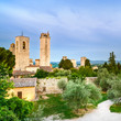 San Gimignano town on sunset, towers and park. Tuscany, Italy
