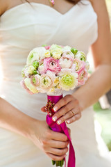 bride with Closeup of wedding flowers