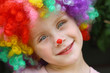 Smiling Child in Clown Costume