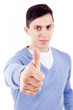 Happy man giving thumbs up sign, focus on the hand
