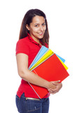 Nice female student carrying notebooks and looking at camera, is