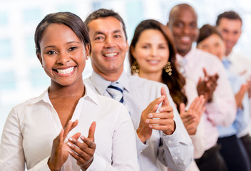 Successful business group applauding