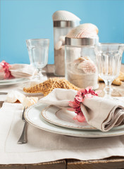Summer table setting decorated with starfish and sea shell