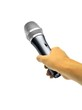 Hand holding microphone on white
