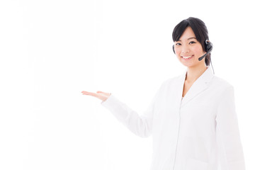 attractive asian doctor with headset on white background