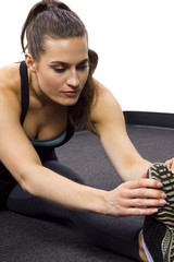 young female fitness trainer yoga stretching