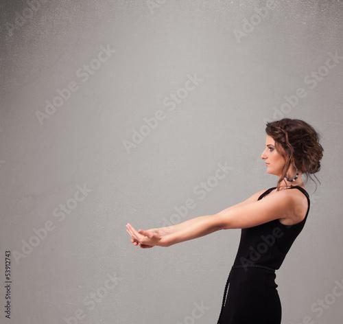 Pretty woman presenting an empty copy space