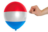 Bursting balloon colored in  national flag of holland
